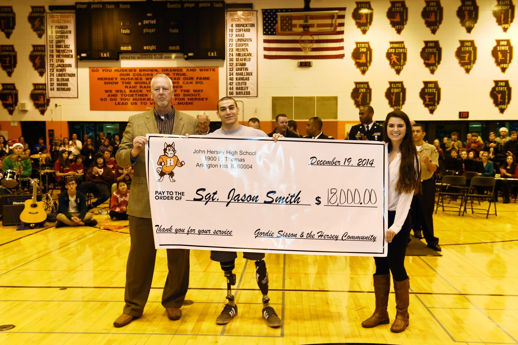 Donation being presented to Sgt. Smith